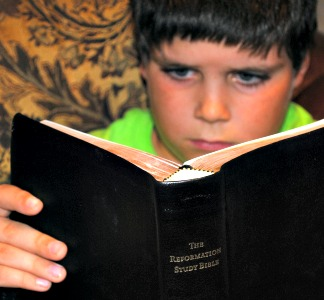 Colin reading Bible